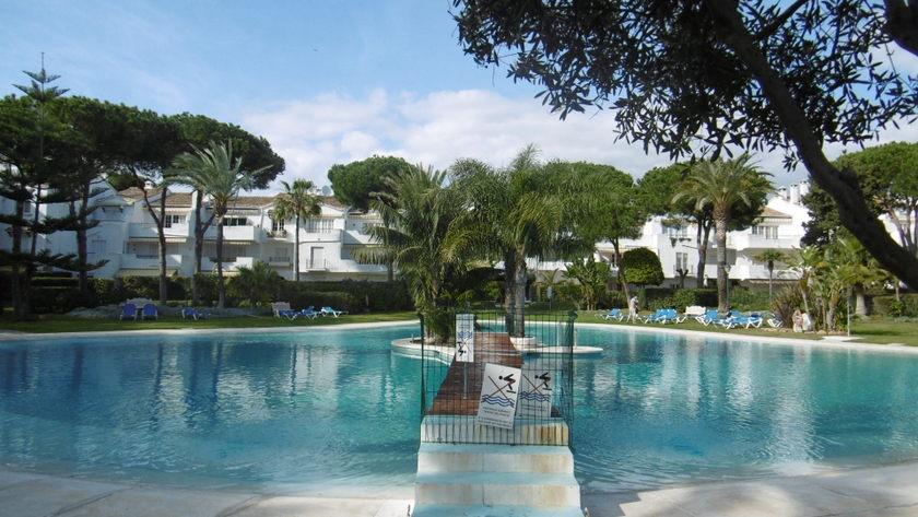El presidente resort garden , pool, tennis.