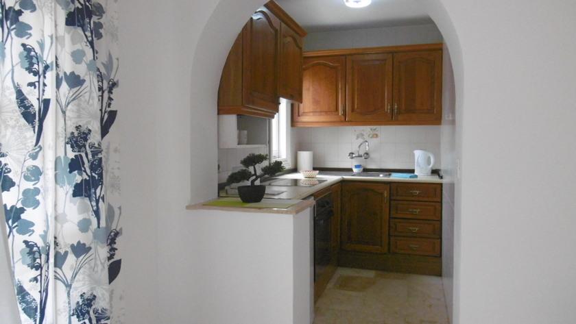 Las Palmeras lounge and kitchen area